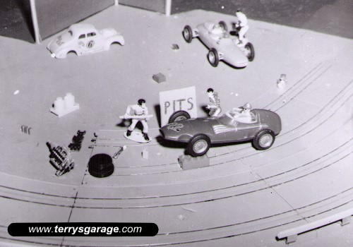 A diorama in the corner of my A.C.Gilbert 1/32 scale slot racing track.. circa 1963.